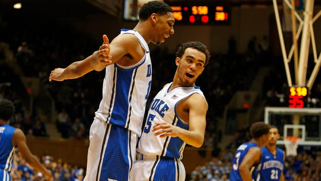 Duke's Jahlil Okafor (15) celebrates with teammate Tyus Jones (5) during the second half against Presbyterian last Friday. Both players were Tom Izzo recruiting targets.