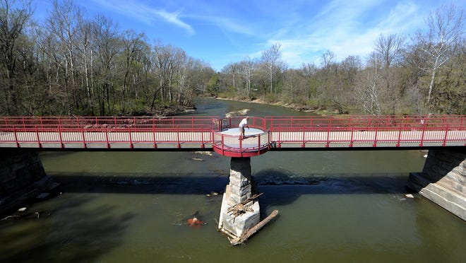 A rollerblader crosses the White River while exercising on the Monon Trail near Westfield Boulevard in April 2014. The Monon Trail at 67th Street is Indianapolis' most-traveled greenway with an estimated 471,018 annual users.