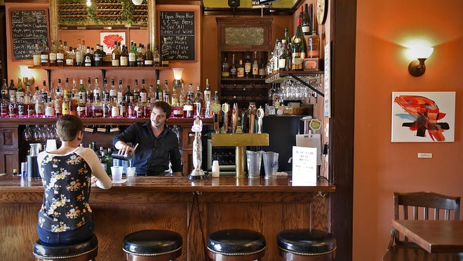 Bartender Charlie Dominick mixes a drink Thursday at the Veranda Lounge. A free concert is planned to celebrate the 10th anniversary of the lounge.