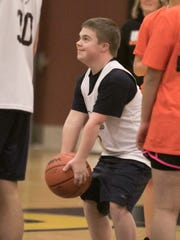 Evan Kurnic shows his love for playing basketball in a game between Hartland Unified and Northville Unified partnering special education students and their peers Thursday, Jan. 25, 2018.