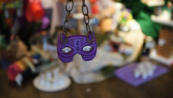 A young artist created a piece of art featuring a mask