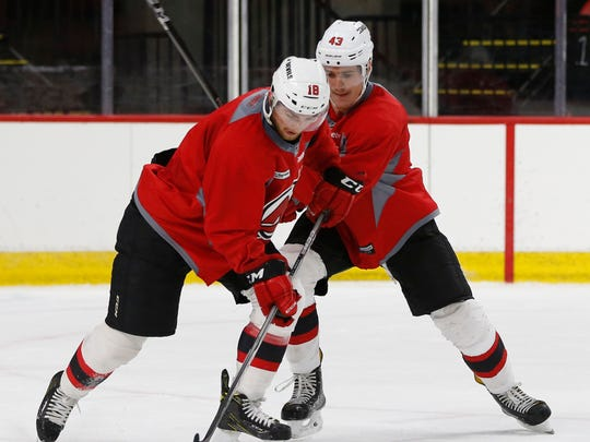 Binghamton Devils forward, Blake Speers keeps the puck away from Ben Thomson during Tuesday's practice at Maines Arena on October 3, 2017.