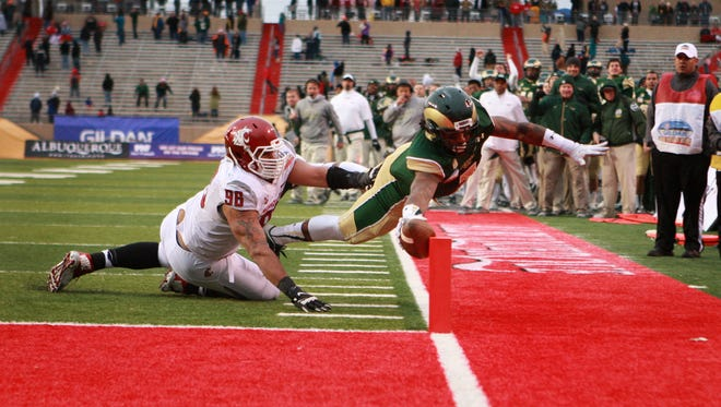 Former CSU running back Donnell Alexander dives into the end zone for a two-point conversion with 33 seconds left to tie the 2008 New Mexico Bowl with Washington State. The Rams recovered a fumble on the ensuing kickoff and won the game with a field goal on the final play.
