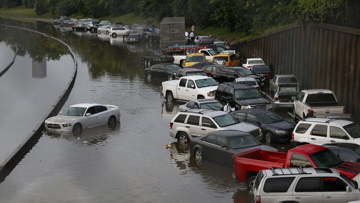 Vehicles left stranded on a flooded Interstate 45 in