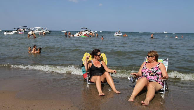 Karen Falco of Irondequoit chats with her cousin, Georgianne DeFranco Cooper of Cape Coral, Florida.