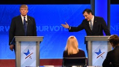 Donald Trump and Ted Cruz participate in the Republican