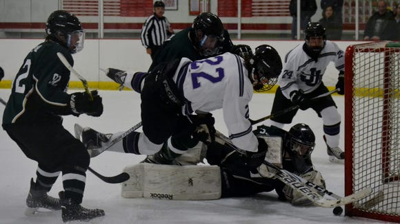 There are league title implications when Brewster/Yorktown and John Jay tangle on Tuesday at Brewster Ice Arena.