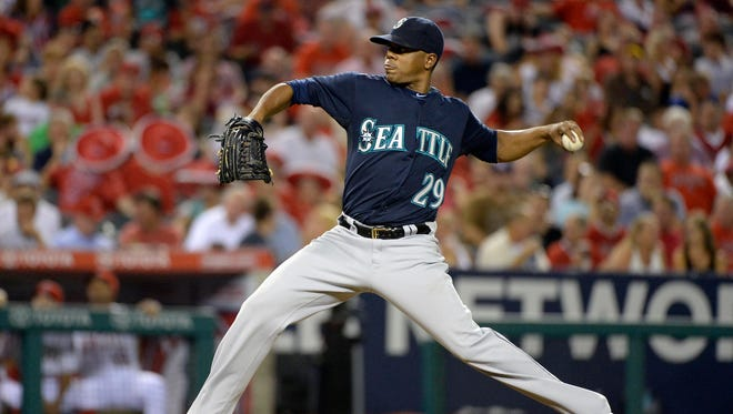 Mariners starting pitcher Roenis Elias throws a pitch against the s Angels during the game at Angel Stadium of Anaheim.