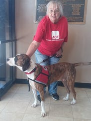 Diane Lewis-Meek with her service dog, Delta, attended