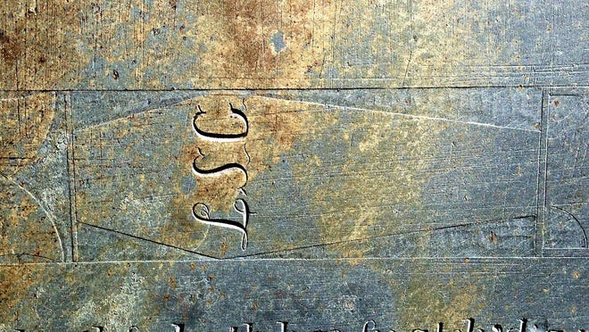 The carving of a coffin is a rare symbol reflecting a darker time in Vermont cemetery artwork. This stone is at Burgess Cemetery in Grafton.