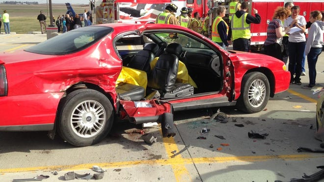 Iowa State Patrol and local fire and rescue crews put on a crash demonstration Wednesday at West Marshall High School in State Center. An extraction device was used to cut off the damaged car door.