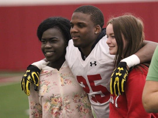 Badgers cornerback Derrick Tindal helps entertain students from McFarland High School in Madison during a recent visit with the UW football team.