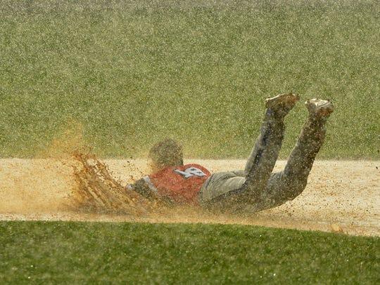 Jacobus' Josh Crimmel dives into second base after
