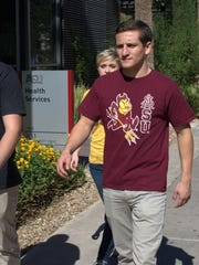 Students walk by ASU Health Services on the Tempe campus.