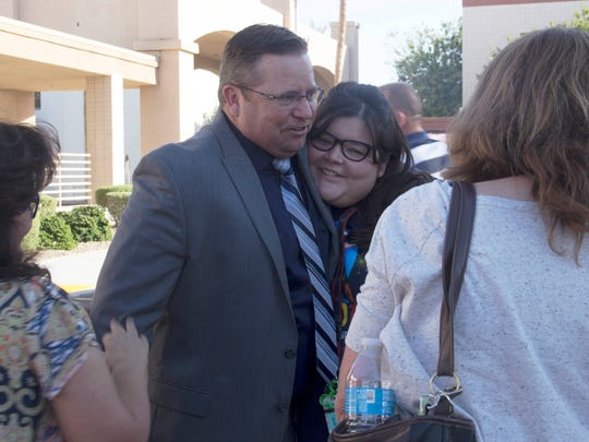 "Shane McCord, recently chosen to lead Gilbert Public Schools as its superintendent, is pictured on Sept. 27, 2017, shortly after signing a contract with the district. Teachers, parents and students attended  a ""pack the parking lot"" event organized by community members to welcome the new superintendent."