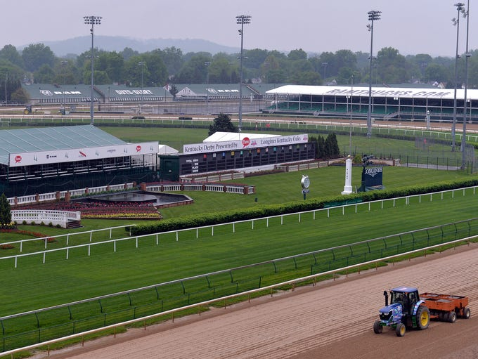 A tractor floats the track in front of the Derby Winners'
