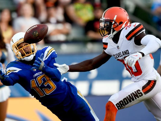 Cleveland Browns cornerback Jason McCourty, right, breaks up a pass intended for Los Angeles Chargers wide receiver Keenan Allen during the second half of an NFL football game Sunday, Dec. 3, 2017, in Carson, Calif. (AP Photo/Kelvin Kuo)