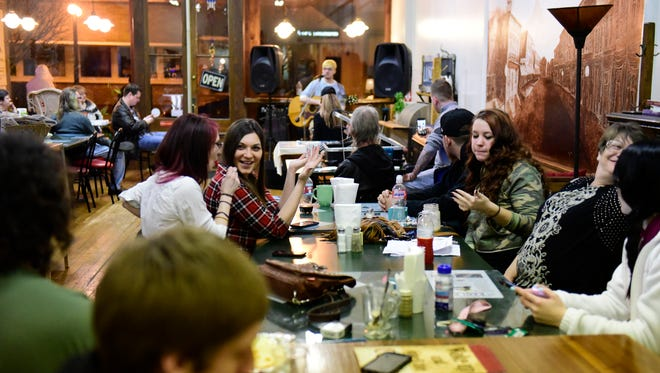 Recovering heroin addicts and their friends socialize outside a sober support meeting on a Friday night at Main Street Cafe in Clyde hosted by Fight For Recovery.