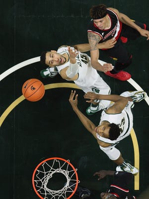MSU's Denzel Valentine, top left, and Deyonta Davis, bottom, have both been invited to Thursday's NBA Draft in Brooklyn, N.Y.