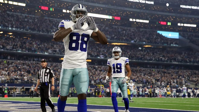 Dallas Cowboys wide receiver Dez Bryant (88) celebrates after scoring a touchdown during the second quarter against the Green Bay Packers in the NFC Divisional playoff game at AT&T Stadium.