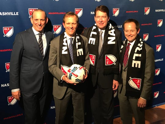 MLS Commissioner Don Garber (far left) poses for a