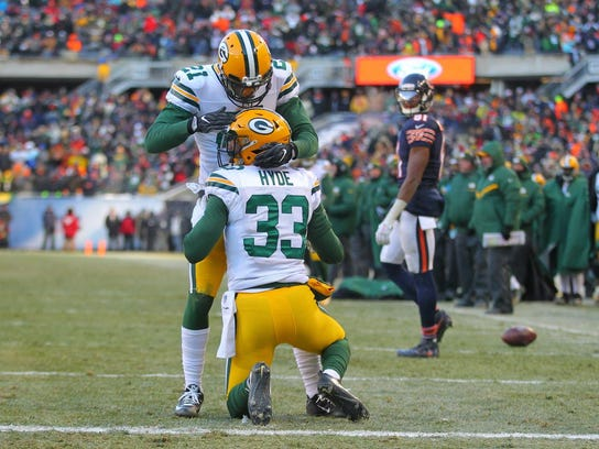 Packers defensive back Micah Hyde is congratulated