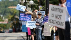 Protesters from both sides of the abortion debate lined