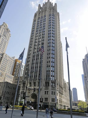 The Chicago Tribune Tower on Michigan Avenue dominates the city block. Gannett, the parent company of the Courier-Post, says it wants to buy rival Tribune Publishing for more than $388 million, in a deal that would give it control of the Los Angeles Times, the Chicago Tribune and several other newspapers.