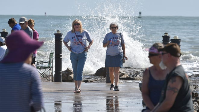 Robbin Fry (left), of Commerce, Mich., and her friend Charlene York, of Belleville, Mich., walk the Fort Pierce jerry March 5, 2018, during their visit to see the New York Mets during spring training.