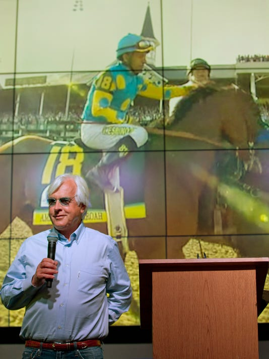 American Pharoah trainer Bob Baffert, lower left, speaks after receiving an award at the ThoroFan Annual Awards Brunch, Friday, Jan. 15, 2016, in Hallandale Beach, Fla. The Triple Crown winner, along with owner-breeder Ahmed Zayat, jockey Victor Espinoza and Baffert are nominees for top honors in Saturday's Eclipse Awards. (AP Photo/Wilfredo Lee)
