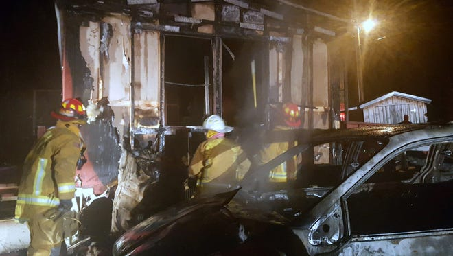 Firefighters battle a mobile home blaze early Saturday, March 26, 2016, in Bath, Steuben County.