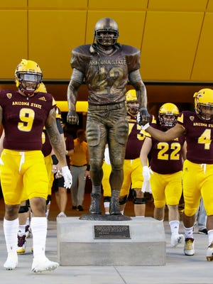 Arizona State players leave the locker room, through the 'TillmanTunnel' and touch the six-footPat Tillmanstatue before playing New Mexico State at Sun Devil Stadium on Thursday, August 31, 2017 in Tempe, Ariz.