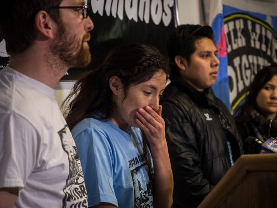 Center, Zully Palacios reacts after speaking about Alex Carrillo at a news conference at the Vermont Workers Center in Burlington, Vt., on Tuesday night, March 28, 2017. Carillo was arrested by ICE along with Palacios and Enrique Balcazar, center right. The two were released but Carillo remains in federal detention.