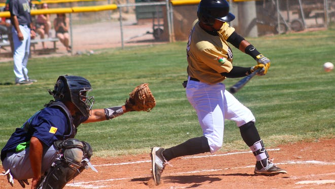 White Sands' Brandon Torres takes a swing at a pitch Friday morning at the Griggs Sports Complex.