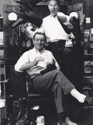 Dennis Shea Sr., seated, opened Dennis Shea's Shoes in 1964 in Lincoln Center. In 1971, his son, Dennis Shea Jr., joined him in the business. On June 30, Dennis Shea Jr. will retire and close the store.