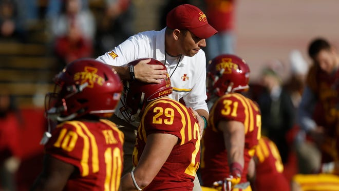 Iowa State head coach Matt Campbell greets Iowa State's Kane Seeley and other players on the field Saturday, Nov. 26, 2016, during pre-game warms ups at Jack Trice Stadium in Ames.