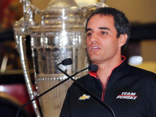 Standing beside the Indianapolis 500 Borg Warner trophy, Juan Pablo ...