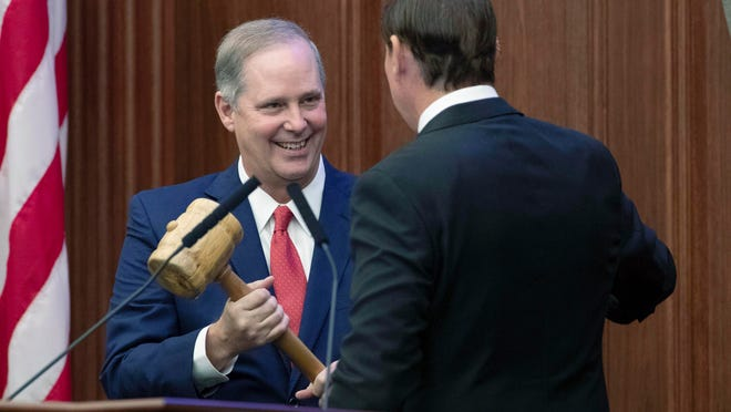 Outgoing Senate President Bill Galvano hands the gavel over to new Senate President Wilton Simpson during the Florida Legislature's Organization Session in Tallahassee on Nov. 17, 2020.