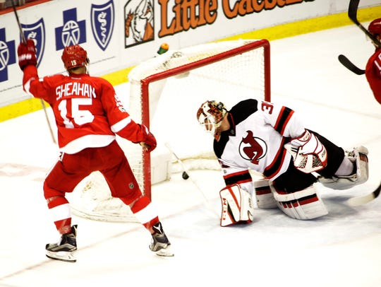 Red Wings center Riley Sheahan scores his second goal