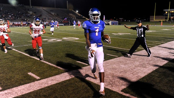 Cooper High School wide-receiver Myller Royals runs out-of-bounds during Friday's game against Grapevine High School Sept. 9, 2017.
