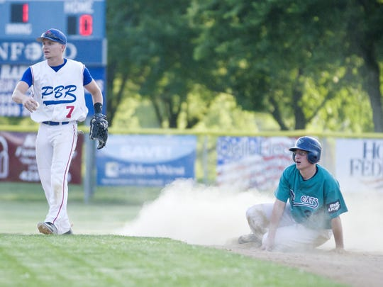 Tanner Solberg of Dell Rapids Pabst Blue Ribbon looks for the call after Kenton Welbig of the Dell Rapids Mudcats slid into second base during Quarry Days Take Me Out to the Ballgame at Rickeman Field in 2016. The two teams will meet for the annual event this year on June 21.