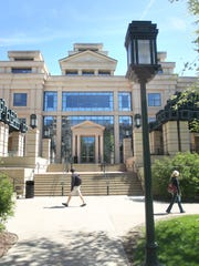 Students walk by the John Pappajohn School of Business