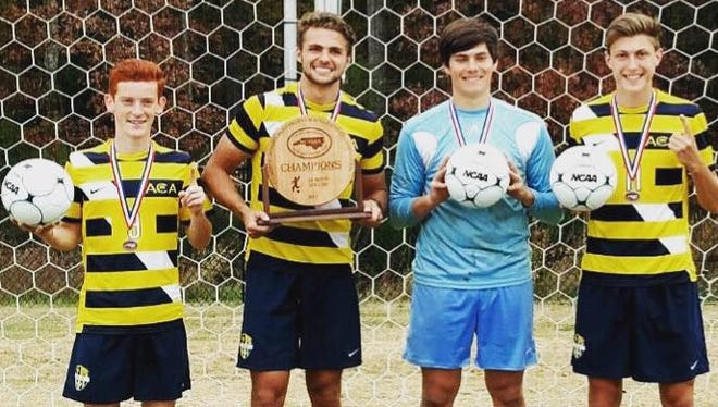Liberty recruit Corban Crosley, second from left, helped the Asheville Christian Academy boys soccer team win a state championship in October.