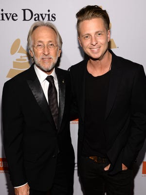 Recording Academy president Neil Portnow, left, and singer/songwriter Ryan Tedder attend the pre-Grammy gala and Salute to Industry Icons  at The Beverly Hilton Hotel on Feb. 7, 2015 in Los Angeles.
