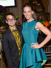 Designer Christian Siriano and actress Hilary Swank attend the 18th Annual ASPCA Bergh Ball at the Plaza Hotel on Thursday, April 9, 2015, in New York.