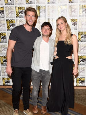 """Liam Hemsworth, Josh Hutcherson, and Jennifer Lawrence of """"The Hunger Games: Mockingjay - Part 2"""" attend the Lionsgate press room during Comic-Con International 2015 at the Hilton Bayfront on July 9, 2015 in San Diego."""