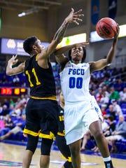 FGCU's DyTiesha Dunson looks to score on Bethune-Cookman's