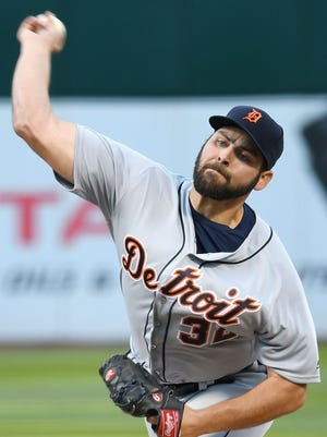 Michael Fulmer of the Tigers pitches in the bottom of the first inning.