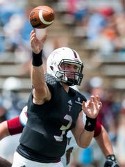 Troy quarterback Sawyer Smith throws during T-Day in