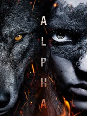 Kodi Smit-McPhee and a wolf in the poster for 'Alpha.'